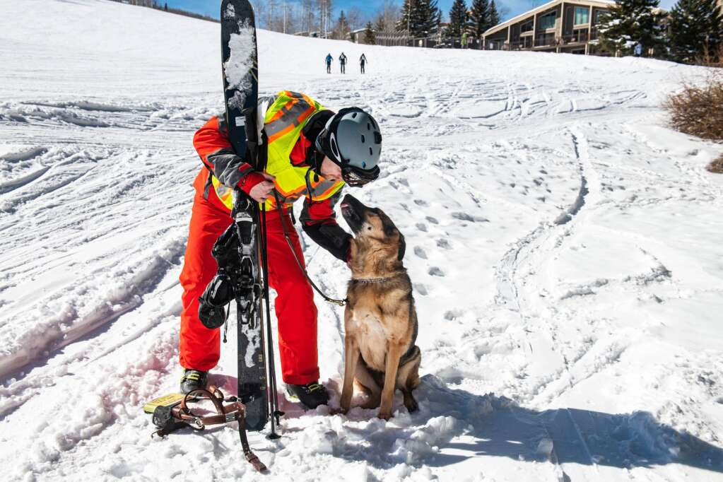 Chad Foster loves on his guide dog, Sarge, after a morning skiing on Snowmass on Monday, Feb. 22, 2021. (Kelsey Brunner/The Aspen Times)