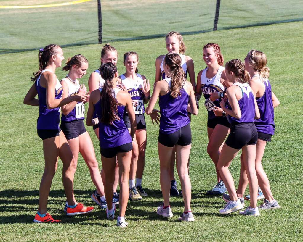The Basalt girls prepare to race in the Longhorn Invitational cross country meet on Saturday, Aug. 28, 2021, at Crown Mountain Park in El Jebel. Photo by Austin Colbert/The Aspen Times.