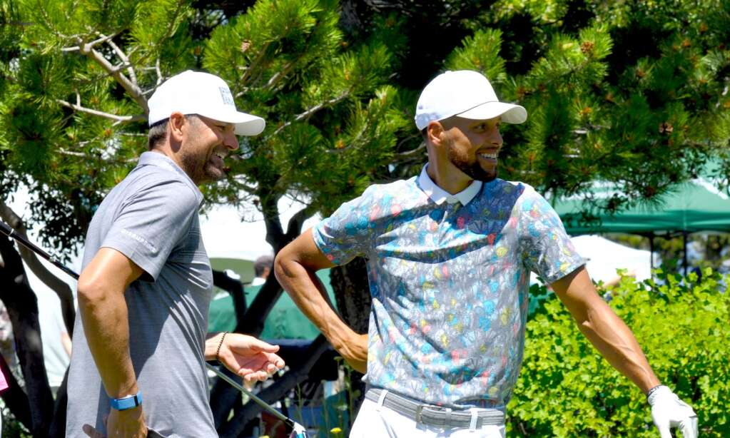 Steph Curry (right) and defending champ Mardy Fish share a laugh.