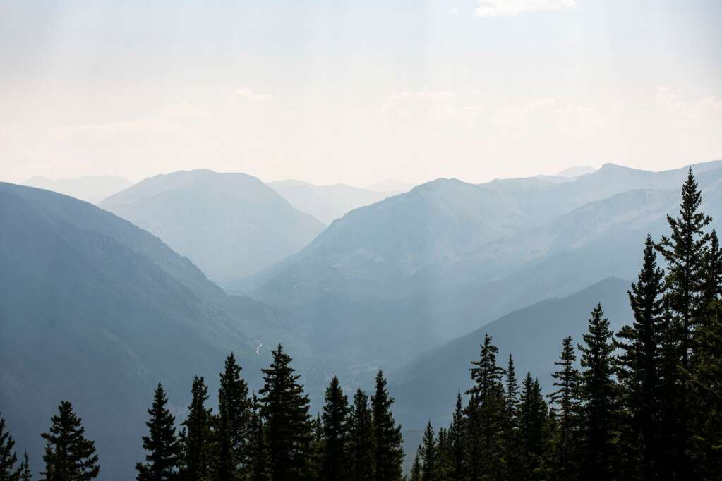A hazy view boasts large mountain views from where the Pandora expansion is proposed on Aspen Mountain on Thursday, August 12, 2021. (Kelsey Brunner/The Aspen Times)