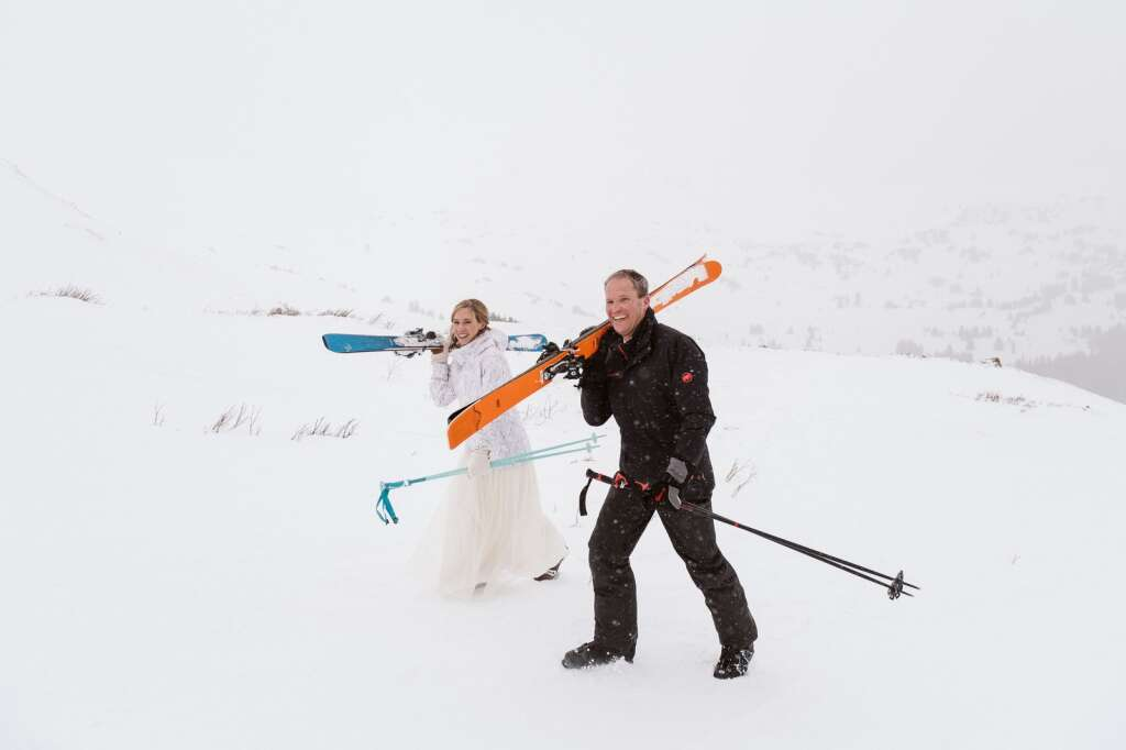 A couple trudges through the snow while eloping in Summit County. | Nina Larsen Reed/Courtesy photo