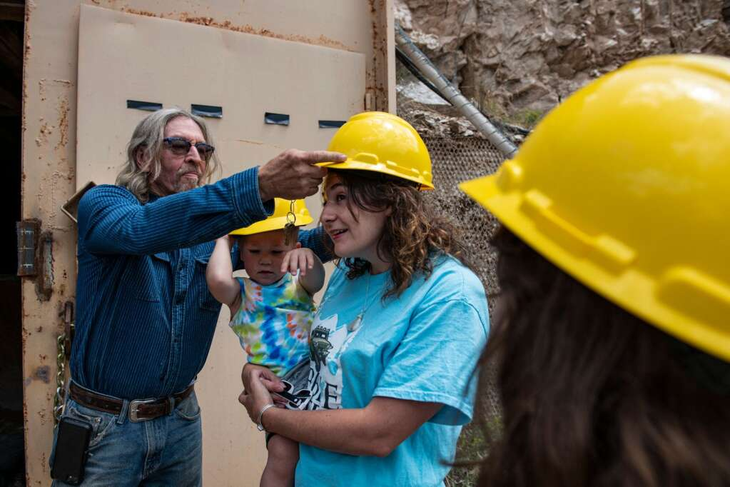 Robert Congdon's daughter-in-law and her children Aisha and James secure their hard hats before entering the White Banks Alabaster Mine outside of Redstone on Thursday, July 29, 2021. (Kelsey Brunner/The Aspen Times)