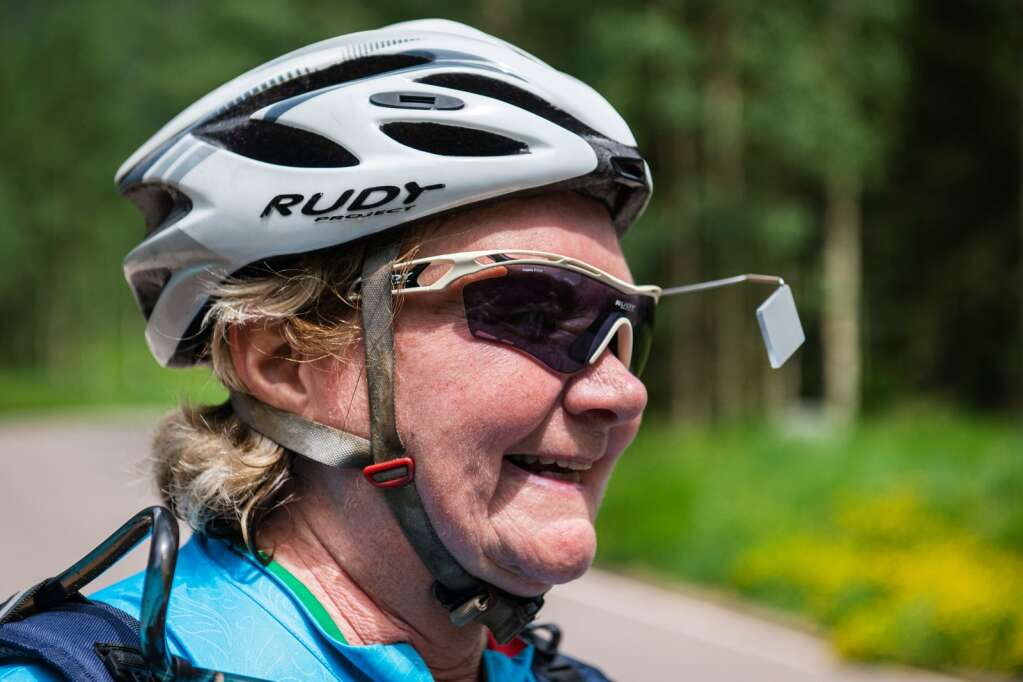 Carol Schreur stands in the parking lot of the Maroon Bells day use area enthusiastically discussing her love of e-bikes in Aspen on Thursday, July 22, 2021. (Kelsey Brunner/The Aspen Times)