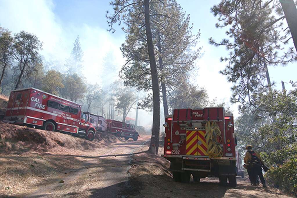 Firefighters from multiple agencies were quick to attack a vegetation fire that started near the Penn Valley community of Lake Wildwood June 29. The fire was kept to less than 10 acres with no structural losses. | Photo: Elias Funez