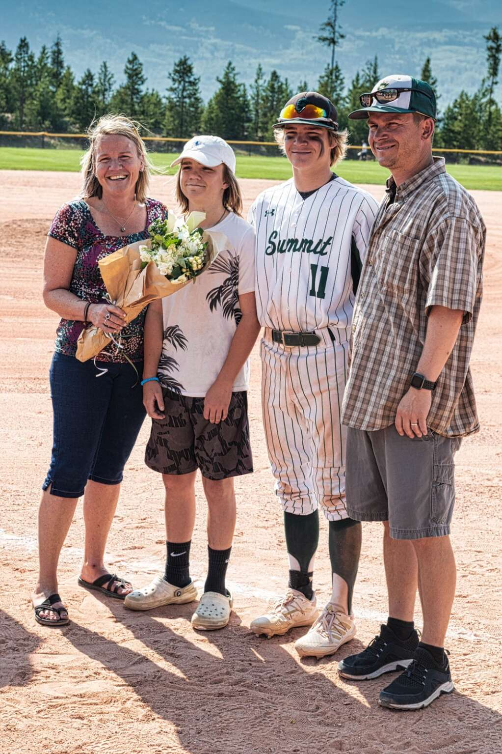 Tigers senior Zach Misch poses for a senior day photo with his family during Summit's pair of wins over Steamboat Springs at the Frisco Peninsula Recreation Area in Frisco on Tuesday. | Photo by Joel Wexler / Rocky Mountain.Photography