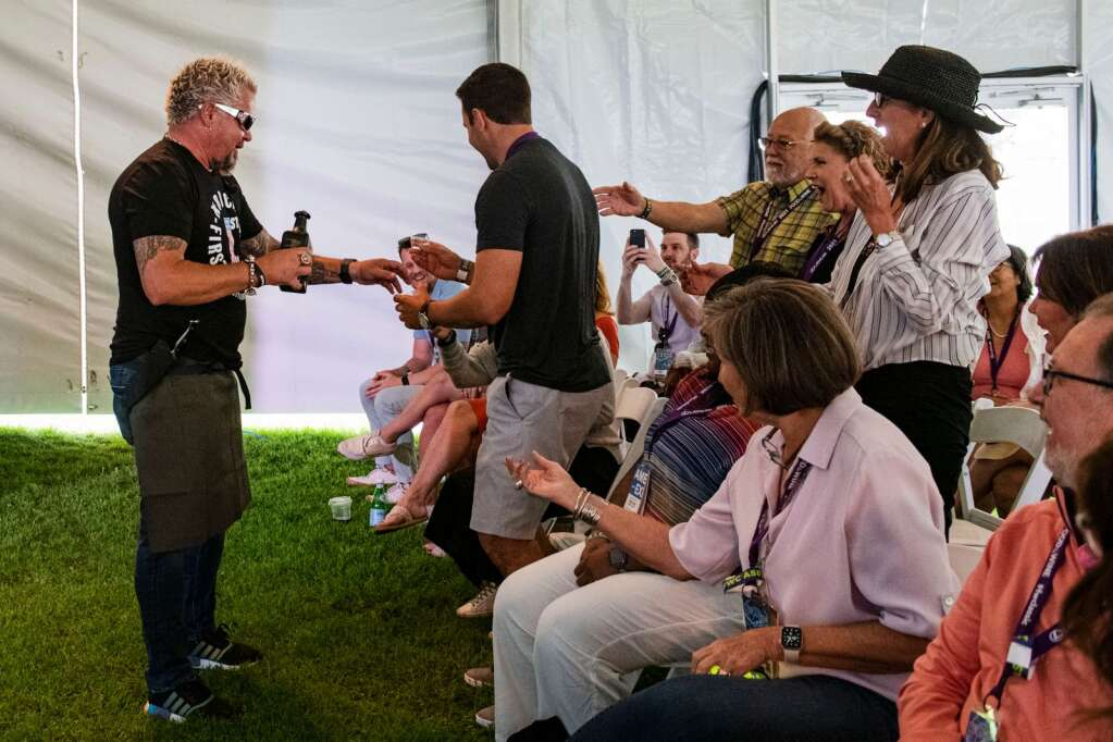 Guy Fieri hands out shots of tequila at his 10 a.m. seminar to attendees in the crowd during the Food & Wine Classic in Aspen on Saturday, Sept. 11, 2021. (Kelsey Brunner/The Aspen Times)
