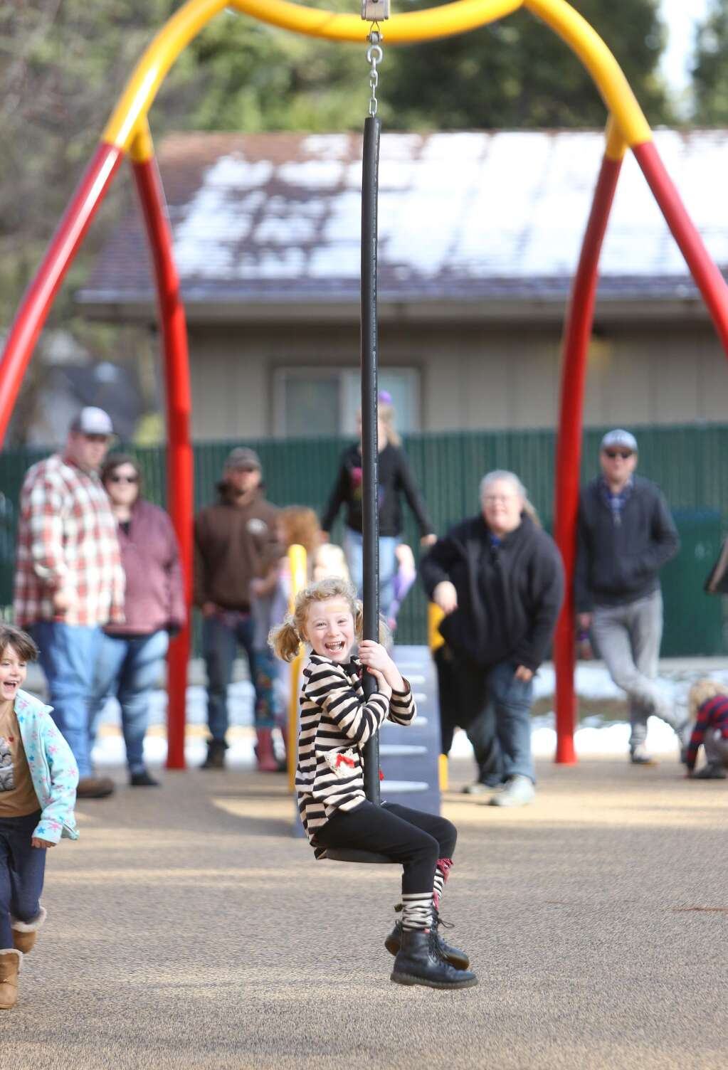 Camilla Makinson holds on tight to the popular zip line swing Jan. 20 at recently renovated Minnie Park in Grass Valley. | Photo: Elias Funez