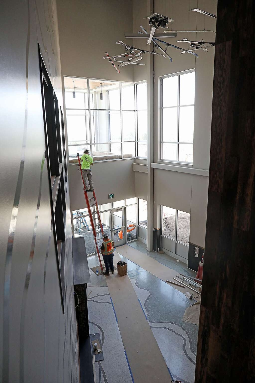 Workers install window seals in the entry of the new Sleeping Giant School. (Photo by John F. Russell)