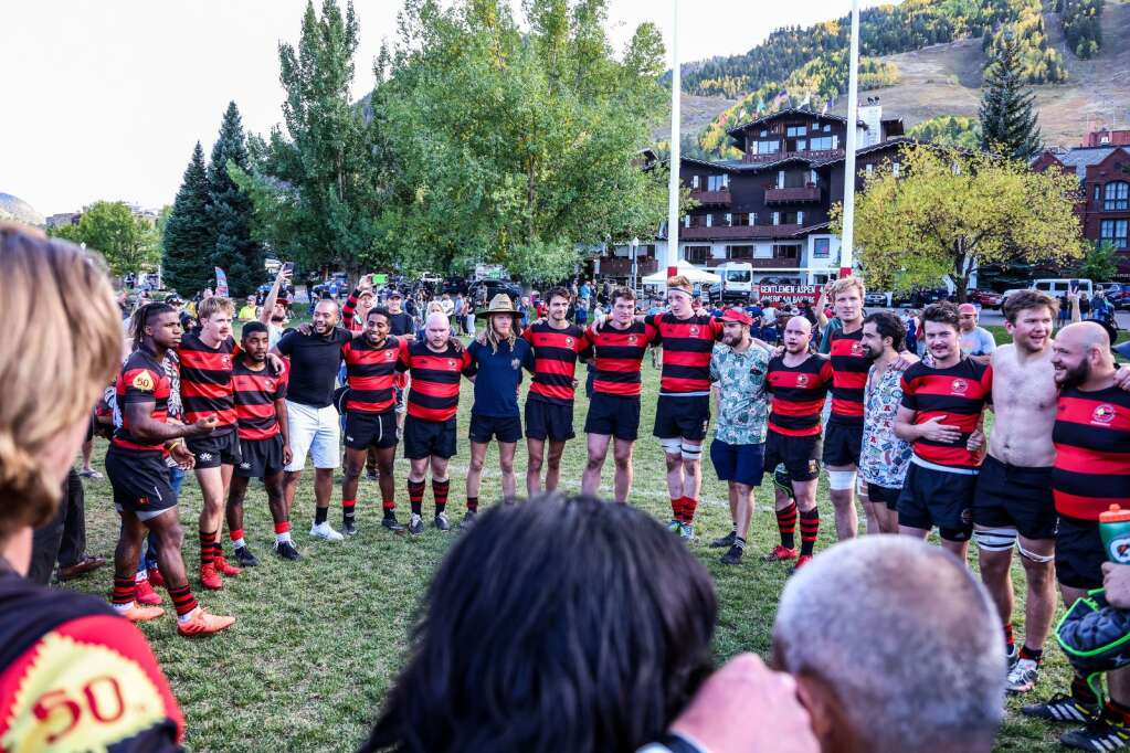 The Gentlemen of Aspen Rugby Club circles up after beating the American Raptors to win Ruggerfest 53 on Sunday, Sept. 26, 2021, on Wagner Park in downtown Aspen. Photo by Austin Colbert/The Aspen Times.