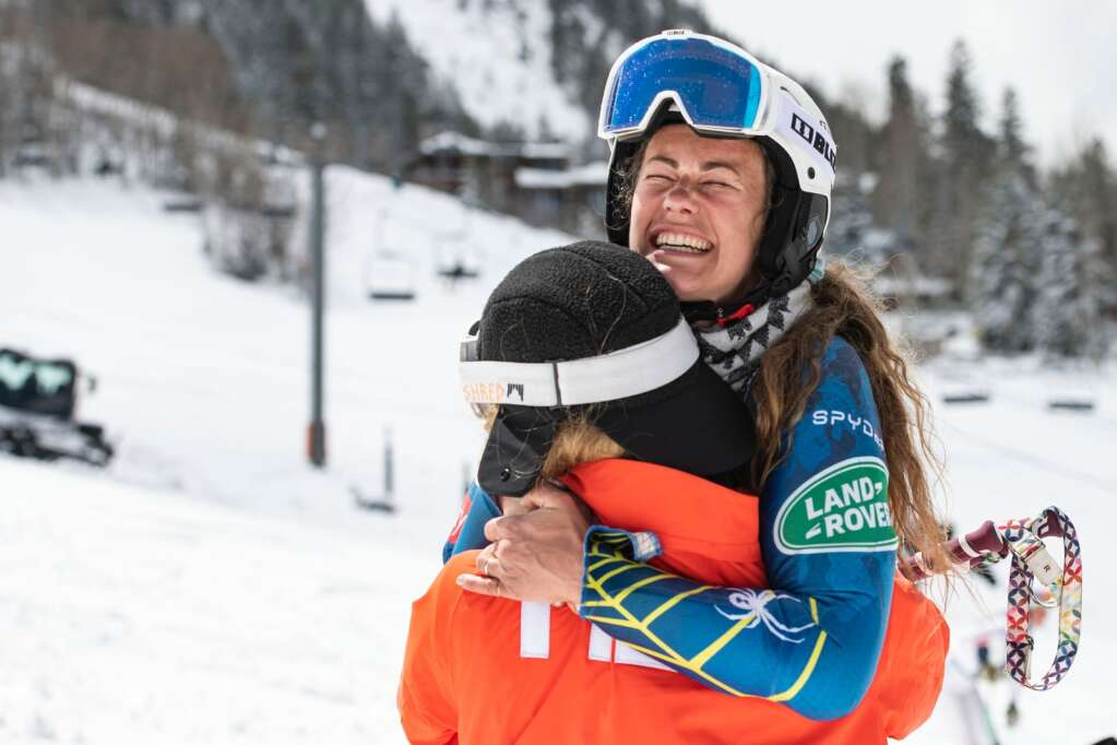 American alpine skier Resi Stiegler hugs friend and fellow skier Sarah Schleper after Stieger won the Women's Slalom National Championships at Aspen Highlands on Friday, April 16, 2021. (Kelsey Brunner/The Aspen Times)