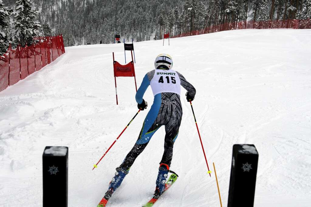 Summit High School Alpine ski team racer Gavin Masters pushes off from the starting gate while competing in giant slalom during a ski competition at Keystone Resort on Friday, Feb. 5, 2021. | Photo by Jason Connolly / Jason Connolly Photography