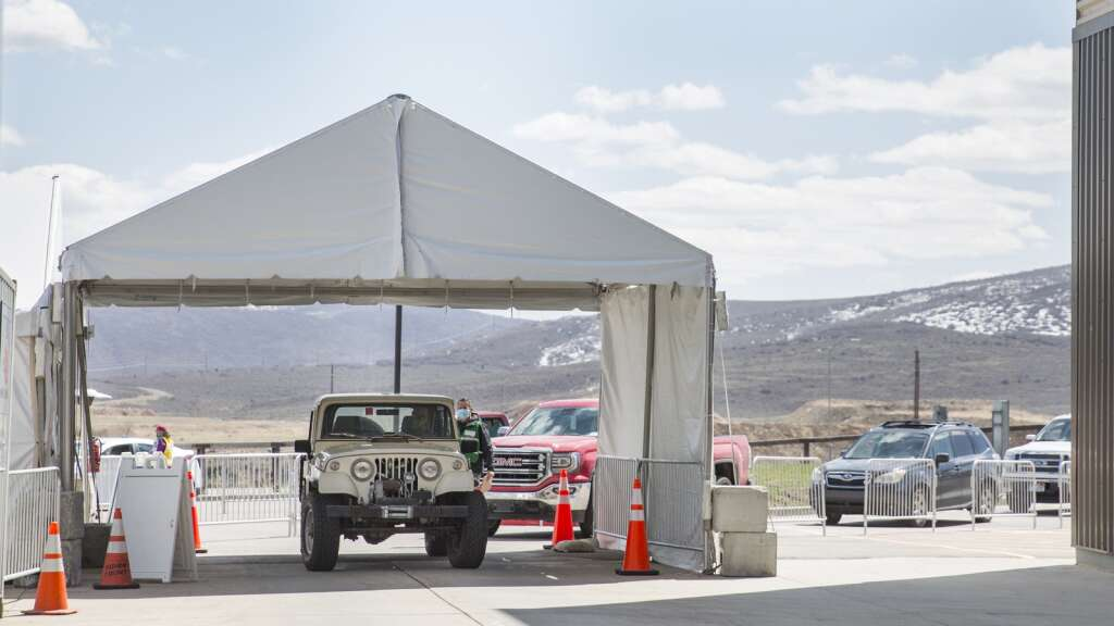 Summit County residents line up at the Utah Film Studios for their COVID-19 vaccines. Officials tout the site's efficiency and say it was designed using the same event-planning principles used for  Olympic Games venues. | Tanzi Propst/Park Record