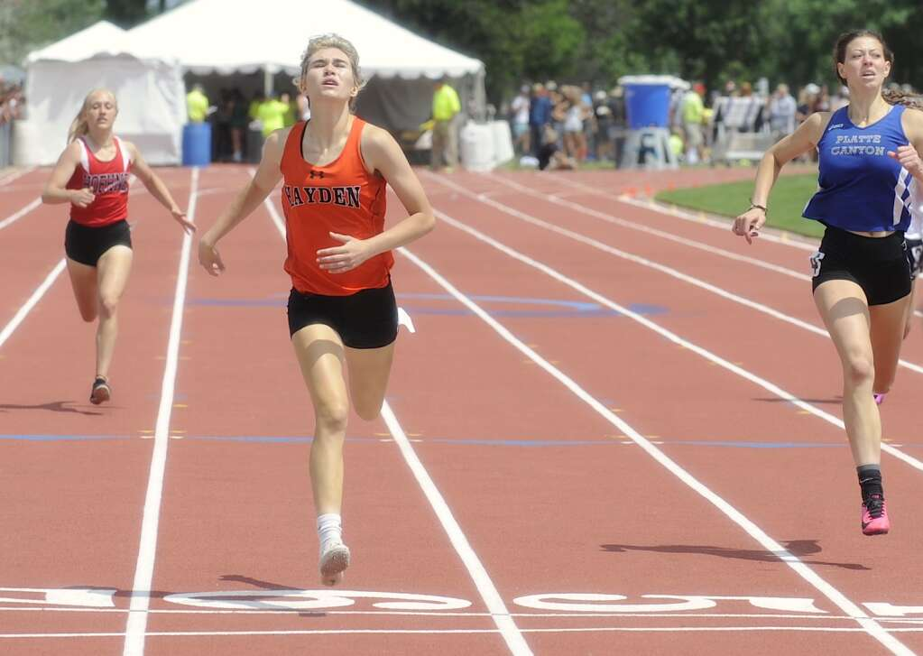 Hayden junior Jillian Bennett edges out a Platte Canyone runner to take second in the 400 at the CHSAA State Track and Field Championships at JeffCo Stadium on Saturday. (Photo by Shelby Reardon)