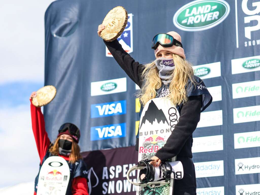 Austria's Anna Gasser, with Hailey Langland in the back, stands atop the women's snowboard slopestyle podium of the U.S. Grand Prix and World Cup on Saturday, March 20, 2021, at Buttermilk Ski Area in Aspen. Photo by Austin Colbert/The Aspen Times.