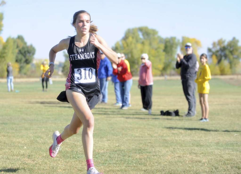 Steamboat Springs senior Caroline Baur sprints to the finish, taking second at a cross country meet at Loudy-Simpson Park in Craig on Saturday morning.   Shelby Reardon/Steamboat Pilot & Today
