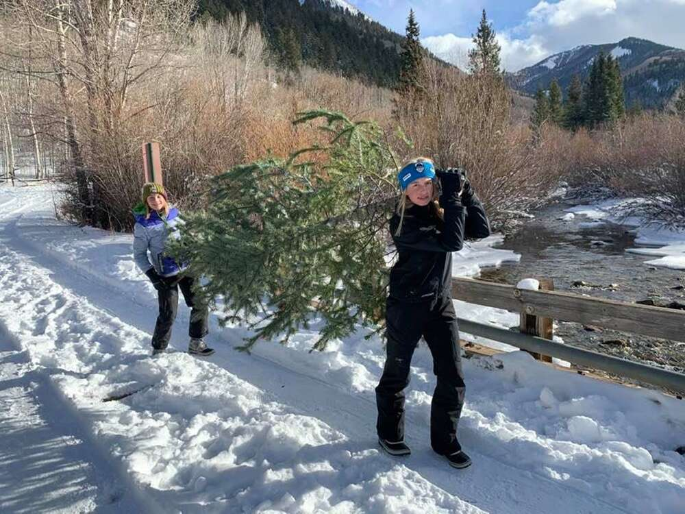 Sisters Devon and Morgan Phillips with their perfectly picked Christmas tree. Ali Phillips photo.