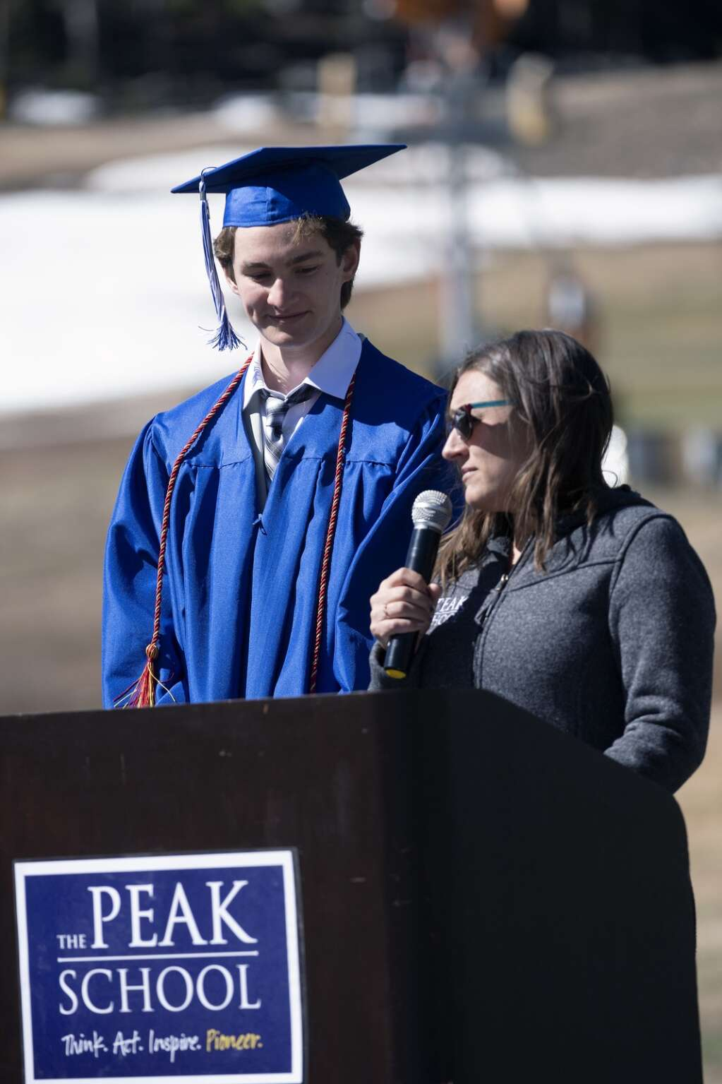Tucker Neal listens as teacher Laura Davies speaks during The Peak School graduation at Copper Mountain Resort on Thursday, May 27.   Photo by Jason Connolly /Jason Connolly Photography