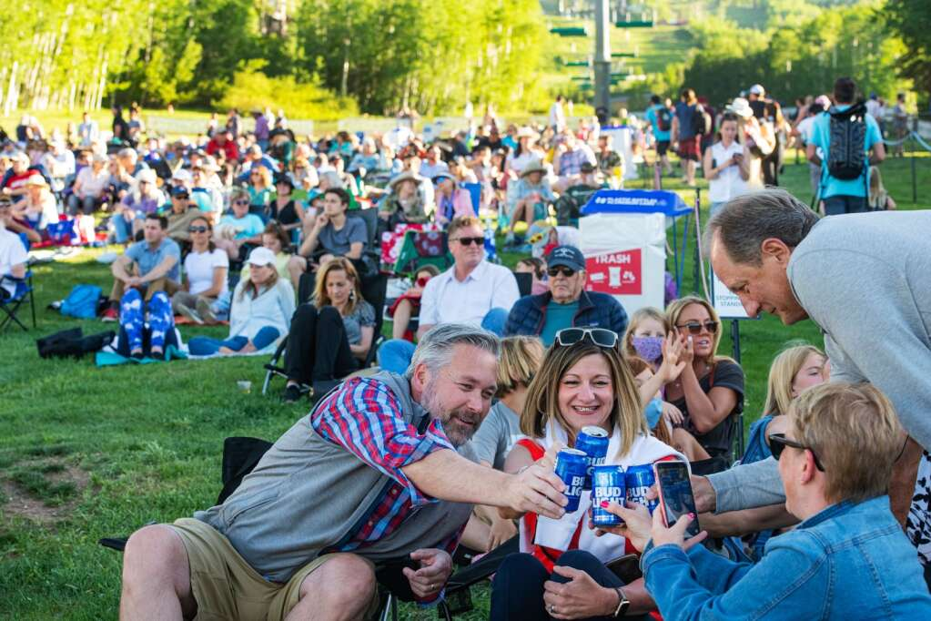 Friends cheer to a fun night at the first free Fanny Hill Concert of the summer at Snowmass Village on Thursday, June 10, 2021. (Kelsey Brunner/The Aspen Times)