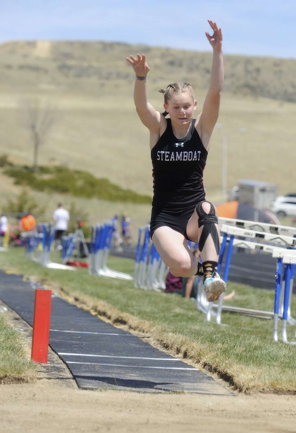 A Steamboat Springs athlete competes in long jump at the Clint Wells Invitational in Craig on Friday. (Photo by Shelby Reardon)