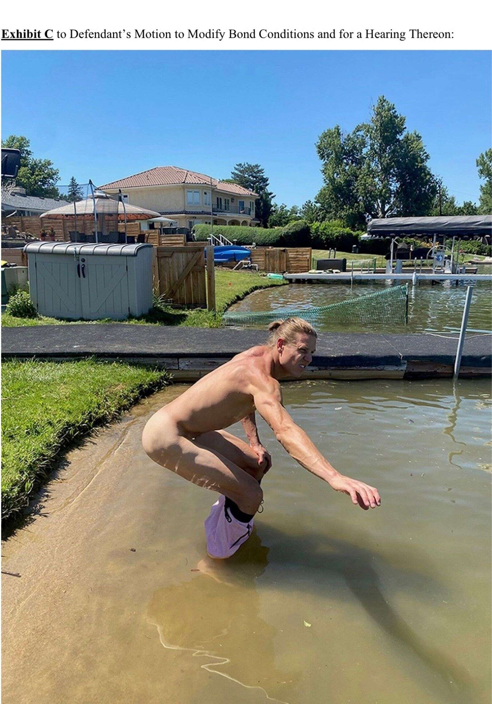 Exhibit C is a photo of Lesh squatting in an unnamed suburban lake or pond.