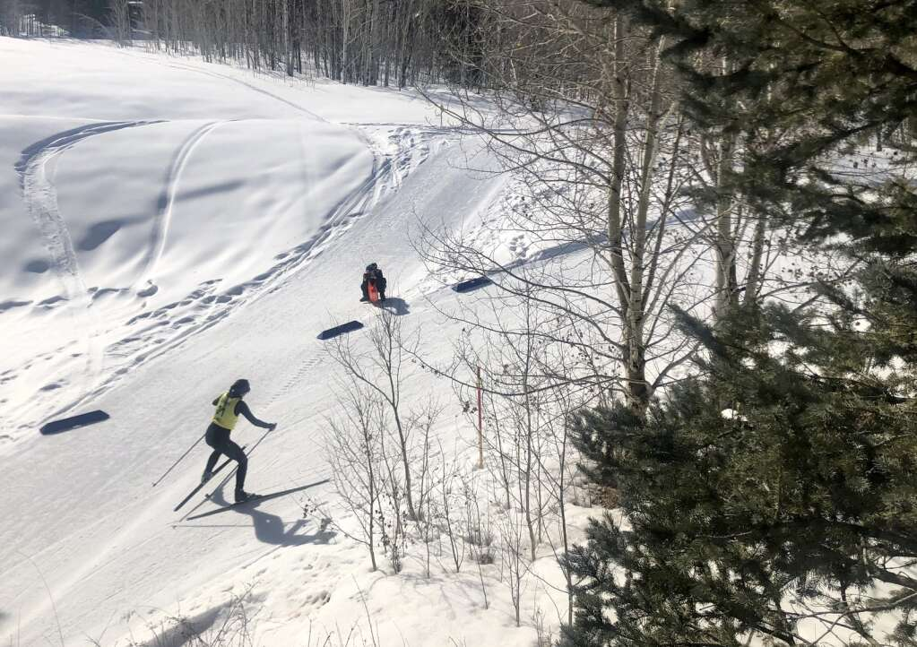 Beryl Coulter skates past a race official while competing in the Owl Creek Chase cross-country ski race in Aspen on March 7, 2021. | Kaya Williams/The Aspen Times