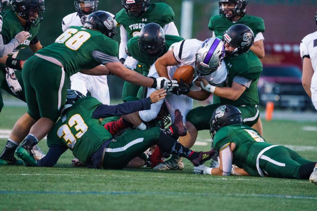 The Summit High School Tigers defense swarms a Skyview ball carrier during the Tigers' 56-0 win over the Skyview Wolverines on Friday, Sept. 3, at Tiger Stadium in Breckenridge.   John Hanson/For the Summit Daily News