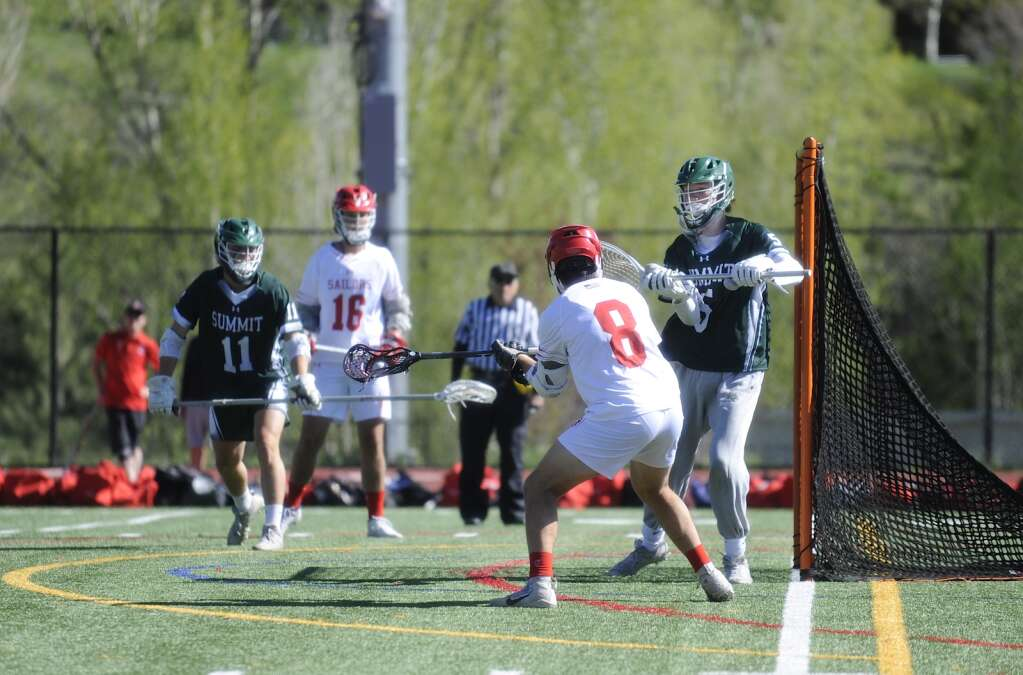Steamboat Springs boys lacrosse senior Aidan Story puts the ball in the net during a game against Summit on Monday evening. He scored a hat trick in the win. (Shelby Reardon)