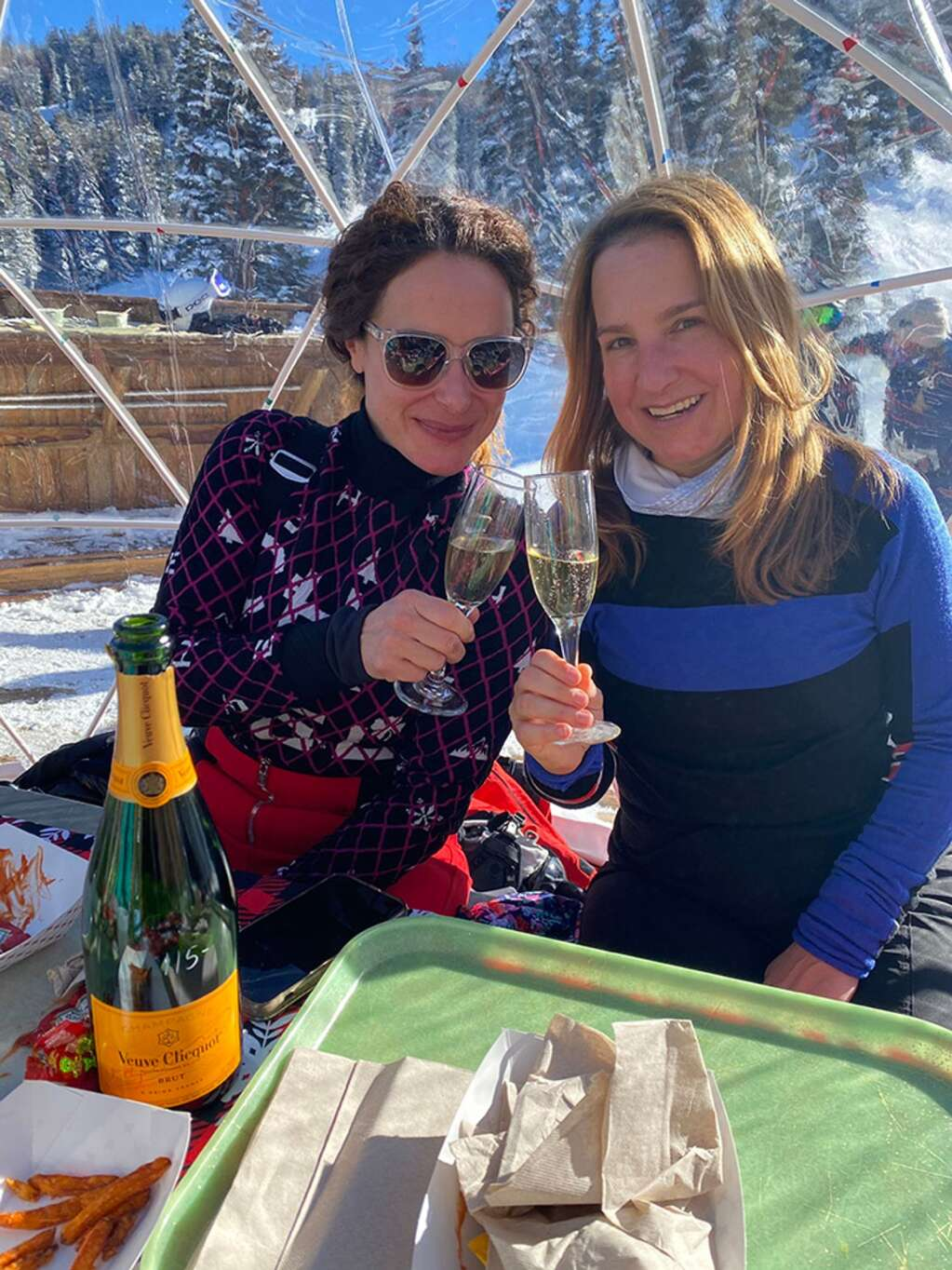 Sari Tuschman and Vicki Shapiro toasting to 2021 in an igloo at Bonnie's.