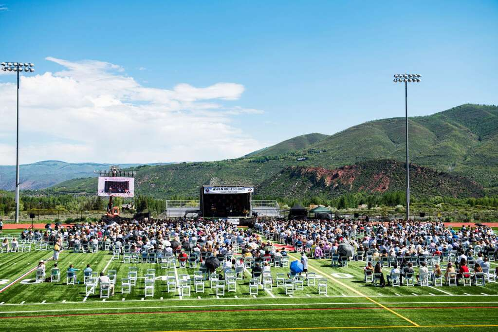 Aspen High School graduates, friends and family take part in the 2021 commencement ceremony on the turf football field at the school on Saturday, June 5, 2021. (Kelsey Brunner/The Aspen Times)