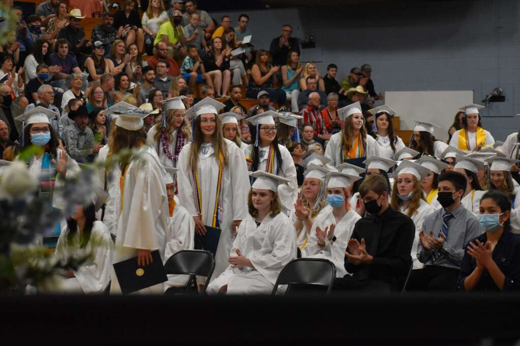 Members of the Class of 2021 stand and receive recognition as scholarship award winners. (Joshua Carney / Craig Press)