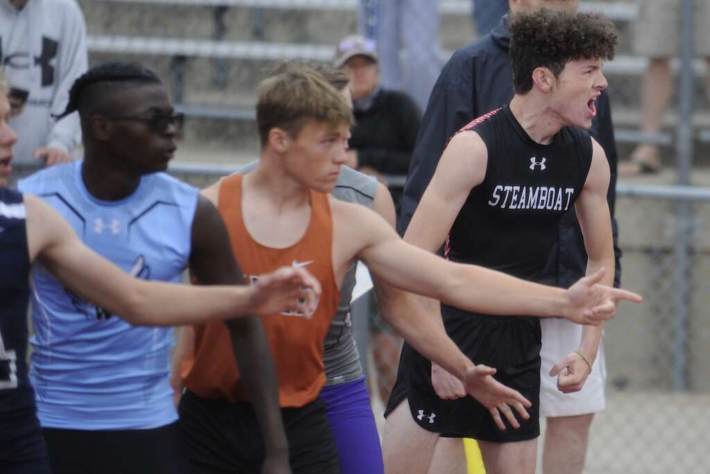 Steamboat Springs runner Connor Prost yells to teammate Bowden Tumminello as he approaches during the 4x400 at the CHSAA Track and Field State Championships at JeffCo Stadium on Friday. (Photo by Shelby Reardon)