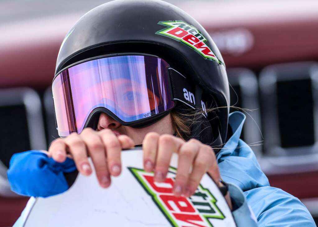 Julia Marino watches the monitor after her run during the women's snowboard slopestyle final on Friday, Jan. 29, 2021, at Buttermilk Ski Area in Aspen. (Photo by Austin Colbert/The Aspen Times)