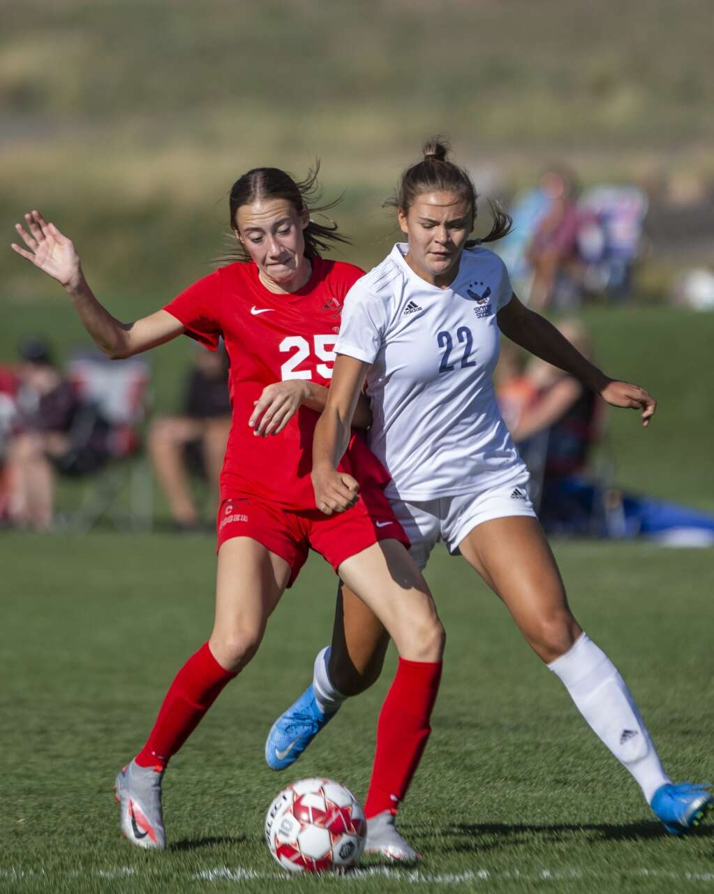 Park City High School's Kate Alderman (25) fights for possession against Skyline High School freshman Matea Liddiard (22) during their matchup at the North 40 playing fields Tuesday afternoon, Sept. 14, 2021. The Miners fell to the Eagles 7-0. (Tanzi Propst/Park Record)