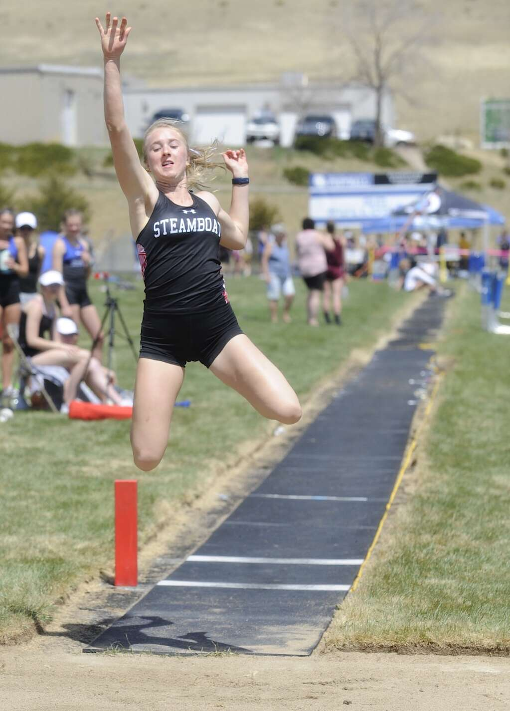 Steamboat Springs senior Marcada Baker competes in the long jump finals at the Clint Wells Invitational in Craig on Friday. (Photo by Shelby Reardon)
