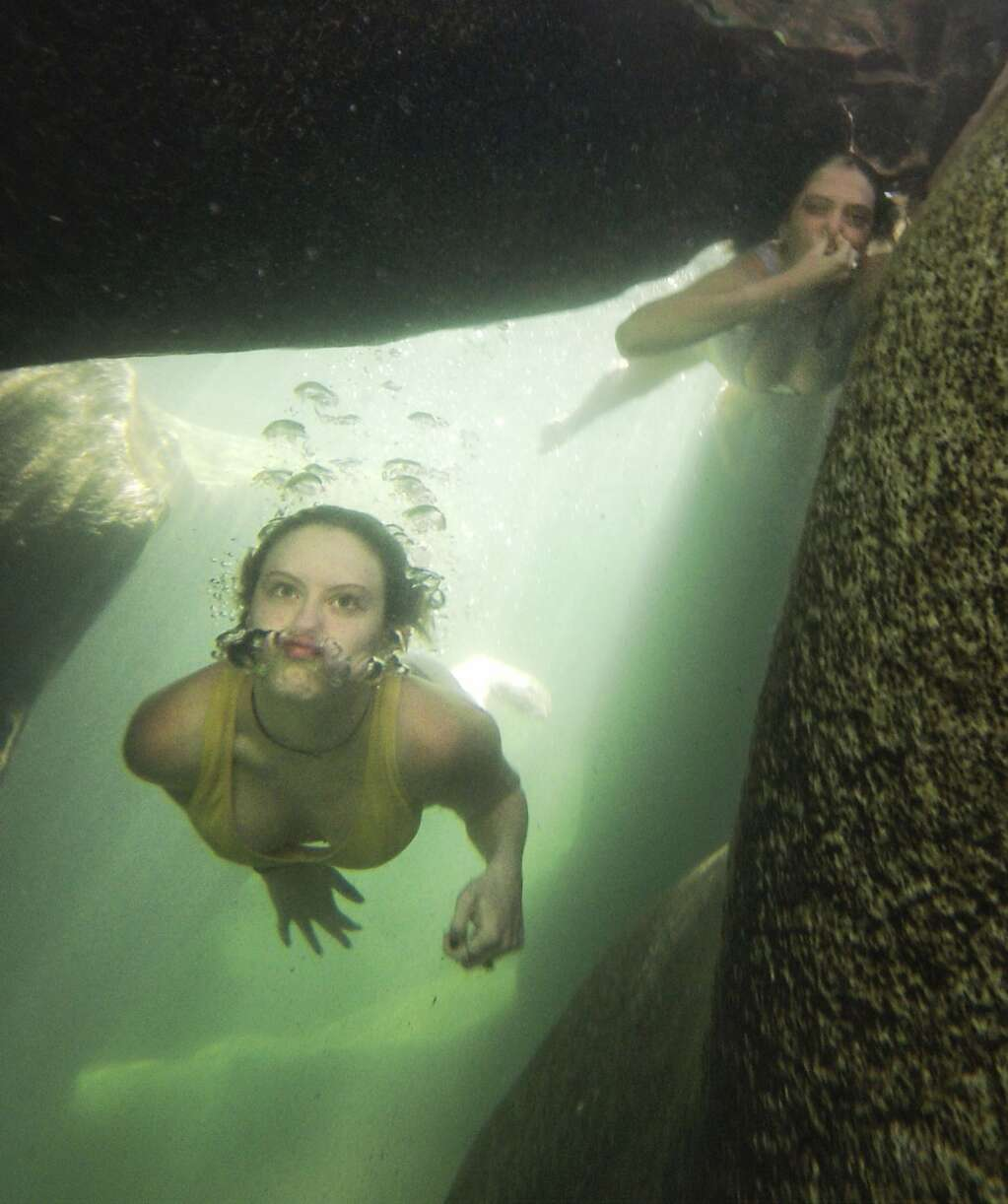 Grass Valley's Bella Holland and Dylan Simmons swim through a rock tunnel of the South Yuba River near the Highway 49 bridge Tuesday. Only people familiar with the underwater hazards of the Yuba should attempt to swim in the tunnels. | Photo: Elias Funez