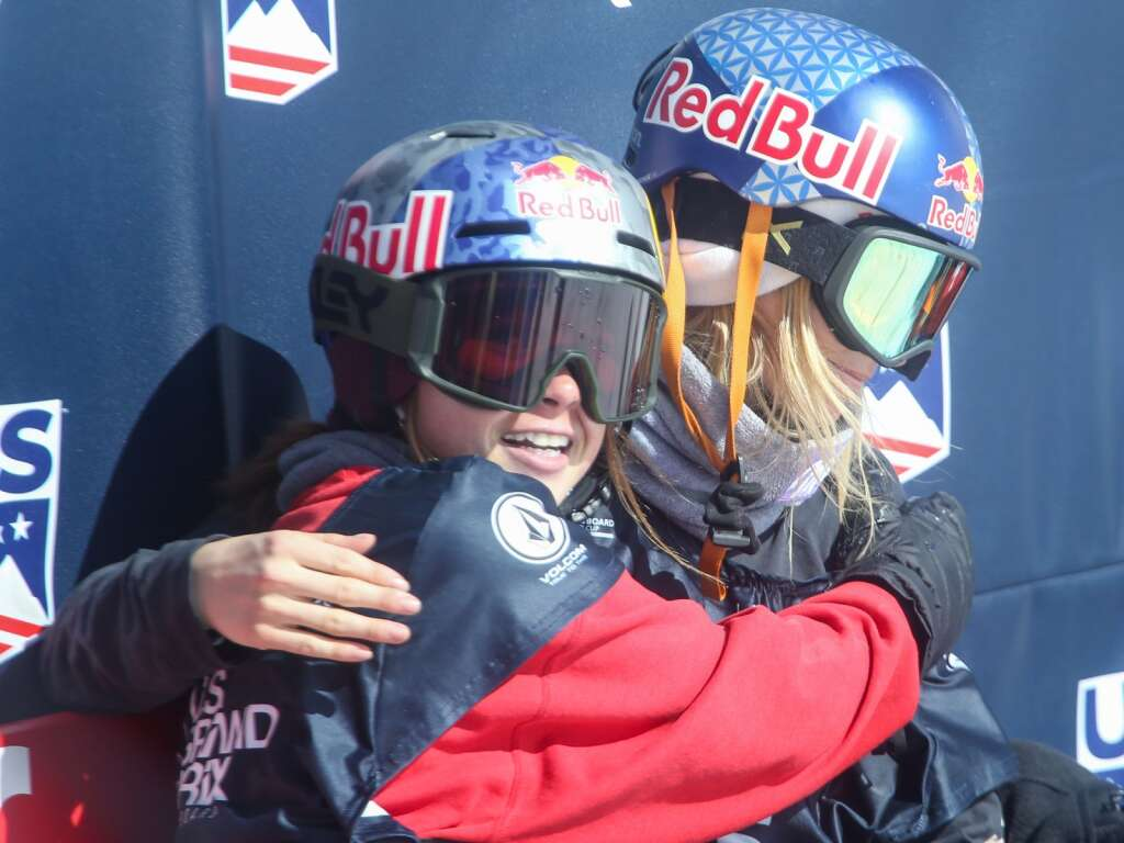 California's Hailey Langland, left, hugs Austria's Anna Gasser during the women's snowboard slopestyle contest of the U.S. Grand Prix and World Cup on Saturday, March 20, 2021, at Buttermilk Ski Area in Aspen. Photo by Austin Colbert/The Aspen Times.
