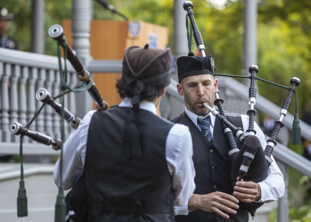 """Bagpipers Scott McDougal and Damian McDougal perform """"Amazing Grace"""" during a ceremony honoring the 20th anniversary of the Sept. 11. terrorist attacks. (Tanzi Propst/Park Record)"""