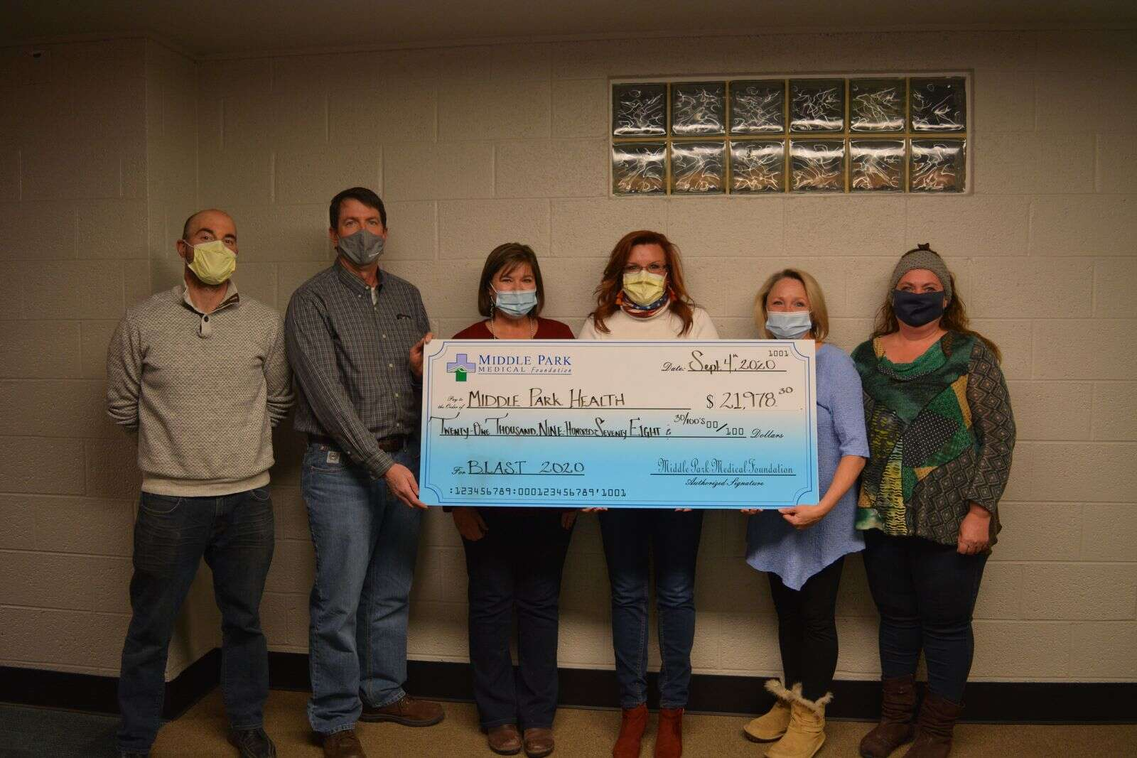 Middle Park Medical Foundation's board members (from left) Andy Radzavich, Frank Delay, Chris Murphy, Jodi Docheff, Kelly Johnson, Kim Cameron accept the BLAST fundraising check.