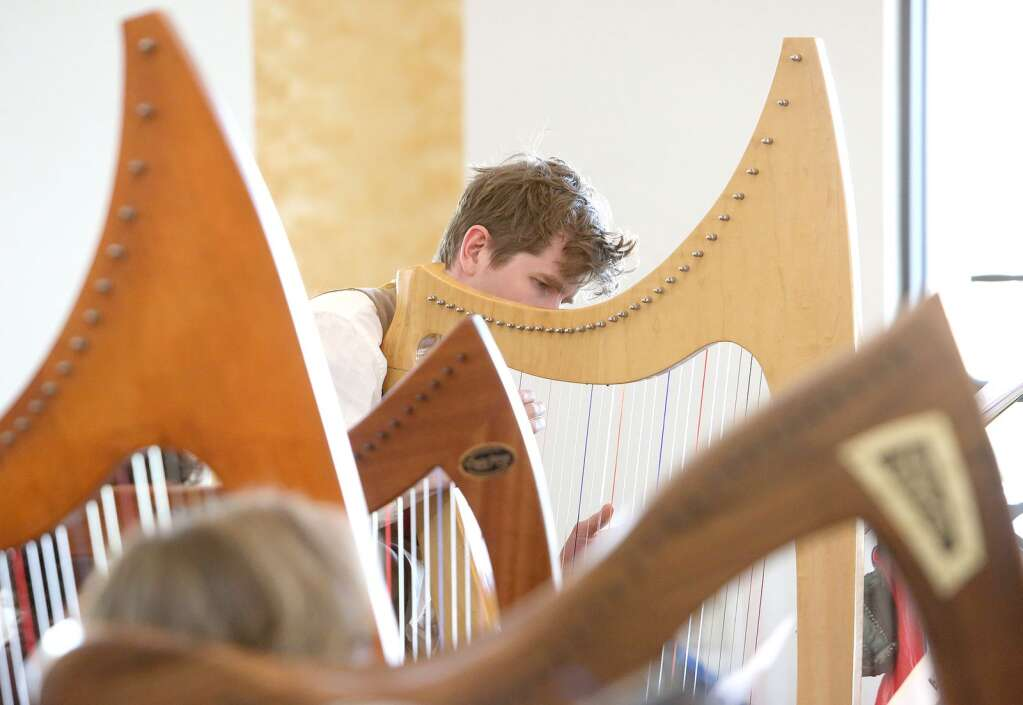 Dalrymple MacAlpin plays the harp as part of the advanced group of learners during a harp workshop held in early March led by Christina Tourin. | Photo: Elias Funez