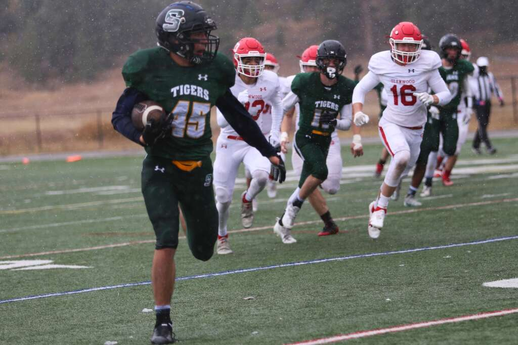 Summit junior Jack Hodge runs with the ball during the Tigers 41-0 win over the Glenwood Springs Demons on Saturday, Oct. 9 at Tiger Stadium in Breckenridge. | Kerri Elam/Courtesy photo