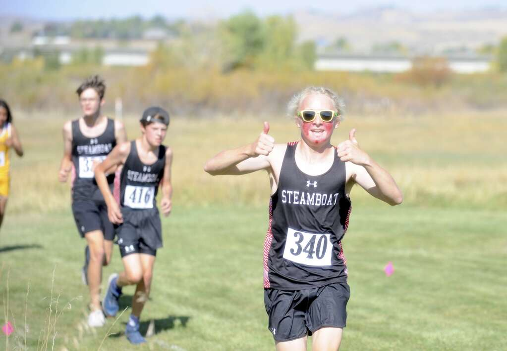 A Sailors runner is all smiles more than halfway through his race a cross country meet at Loudy-Simpson Park in Craig on Saturday morning.   Shelby Reardon/Steamboat Pilot & Today