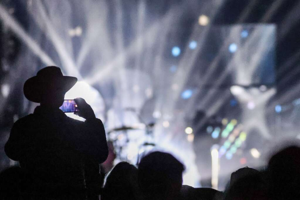 Fans take pictures as Kings of Leon performs during Jazz Aspen Snowmass on Friday, Sept. 3, 2021, in Snowmass Village. Photo by Austin Colbert/The Aspen Times.