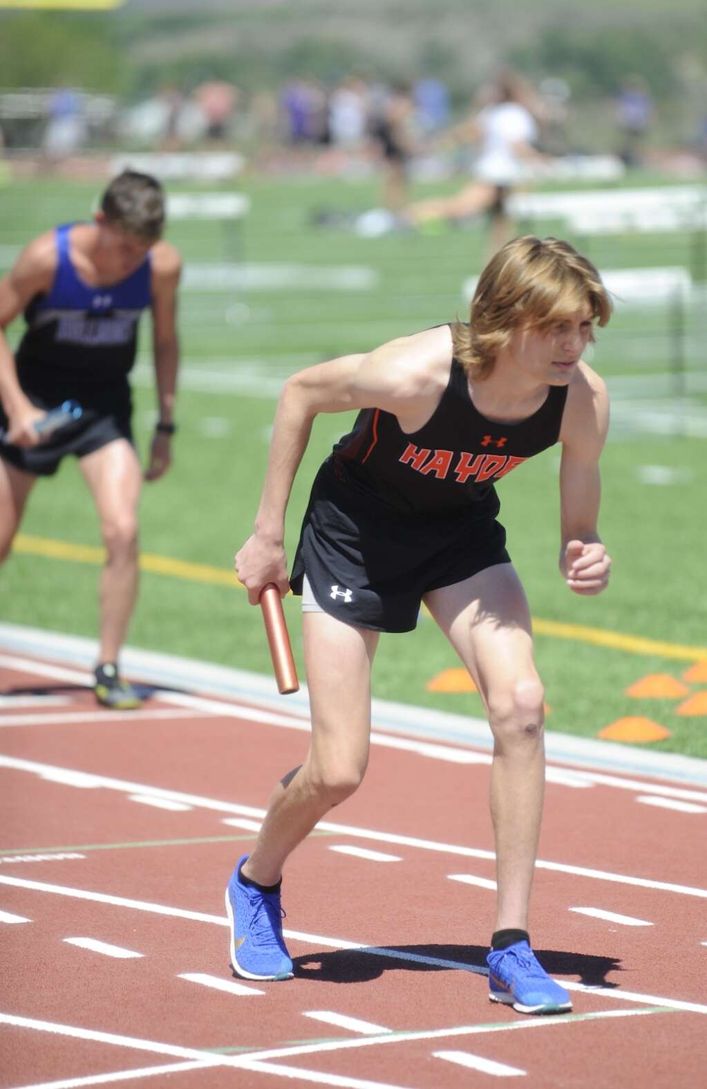 Kale Johnson gets ready to start the 4x800 relay at the Bulldog/Tiger Invite at Hayden High School on Wednesday. (Shelby Reardon)