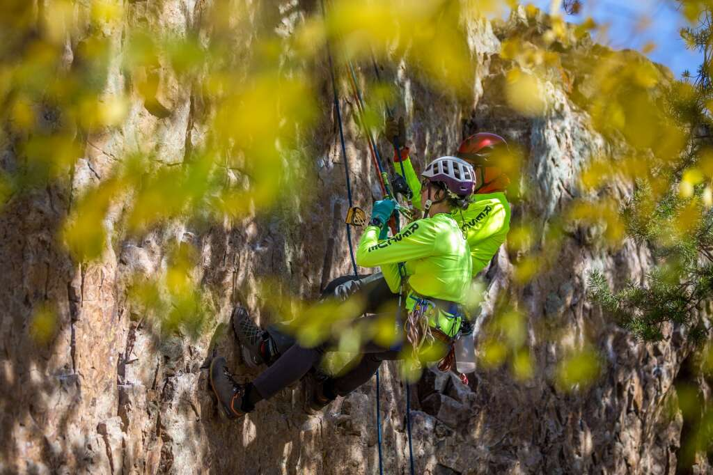 Madeline Ahlborn and Stephen Cline rappelling along a rock face near Windy Point Campground during a search and rescue training session on Friday, September 24.  |  Liz Copan / For the Daily News Summit