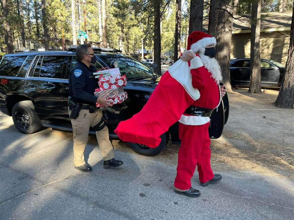 Officer Nixon dressed up as Santa to deliver gifts.