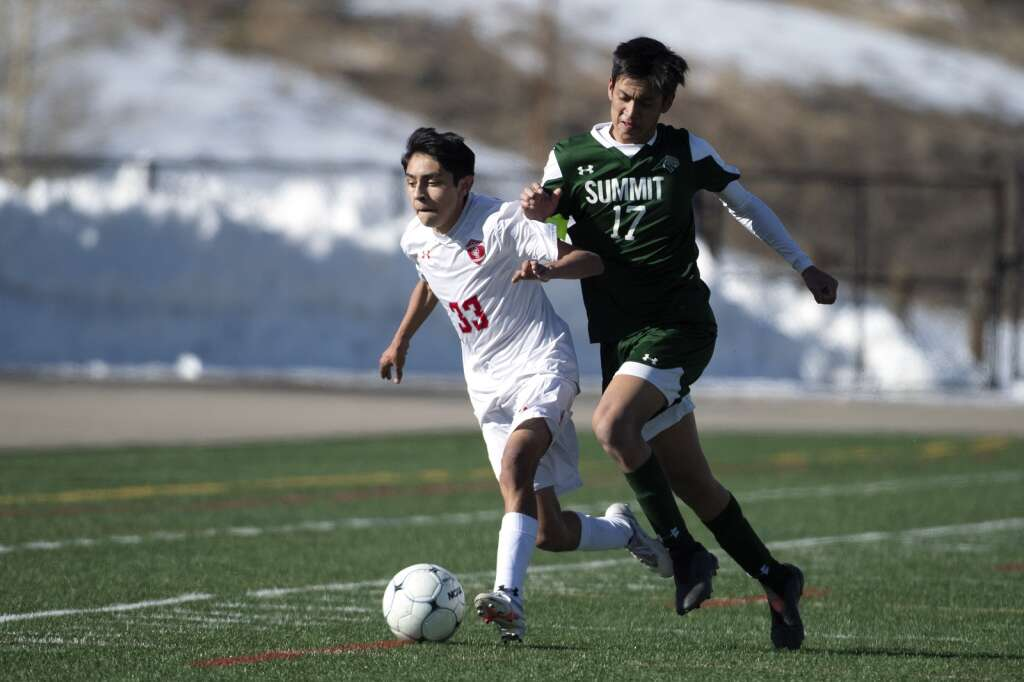 Summit High Tiger Alex Casillas battles for the ball against Steamboat Springs' Gerardo Mendoza during the home opener of the boys varsity soccer season at Climax Molybdenum Field at Tiger Stadium on Thursday, March 18, 2021. The Tigers lost to the Sailors 3-0. | Photo by Jason Connolly / Jason Connolly Photography