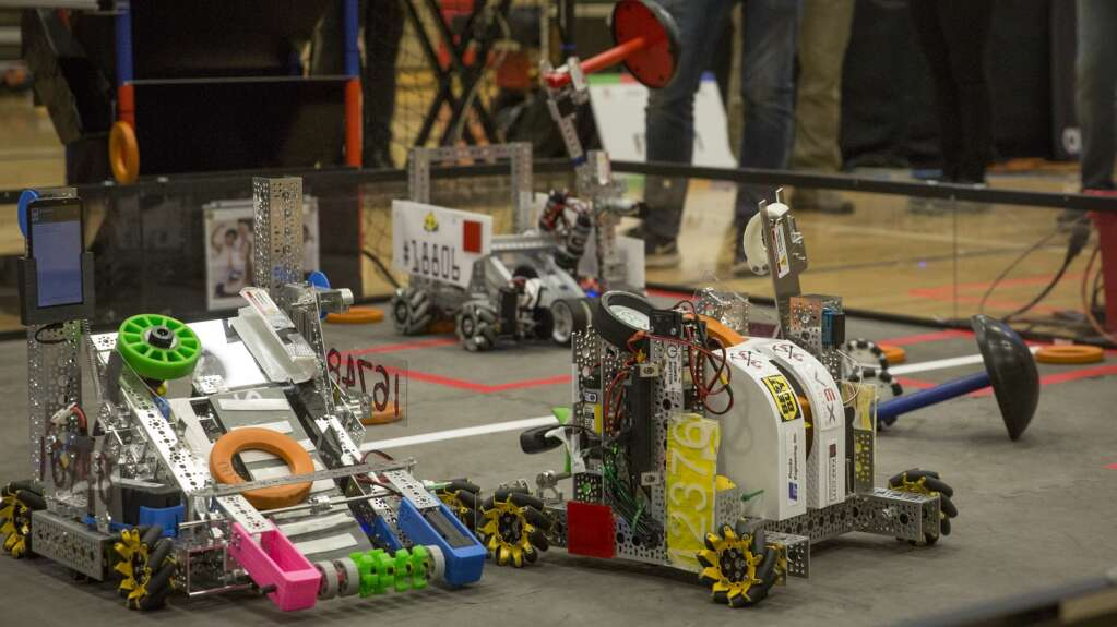 Robots from Team 12376 Yolt, right, and Team 16748 Monochromats vie for orange disks in the pits during a qualifying round at the Park City Qualifier on Saturday, April 3, 2021. (Tanzi Propst/Park Record)