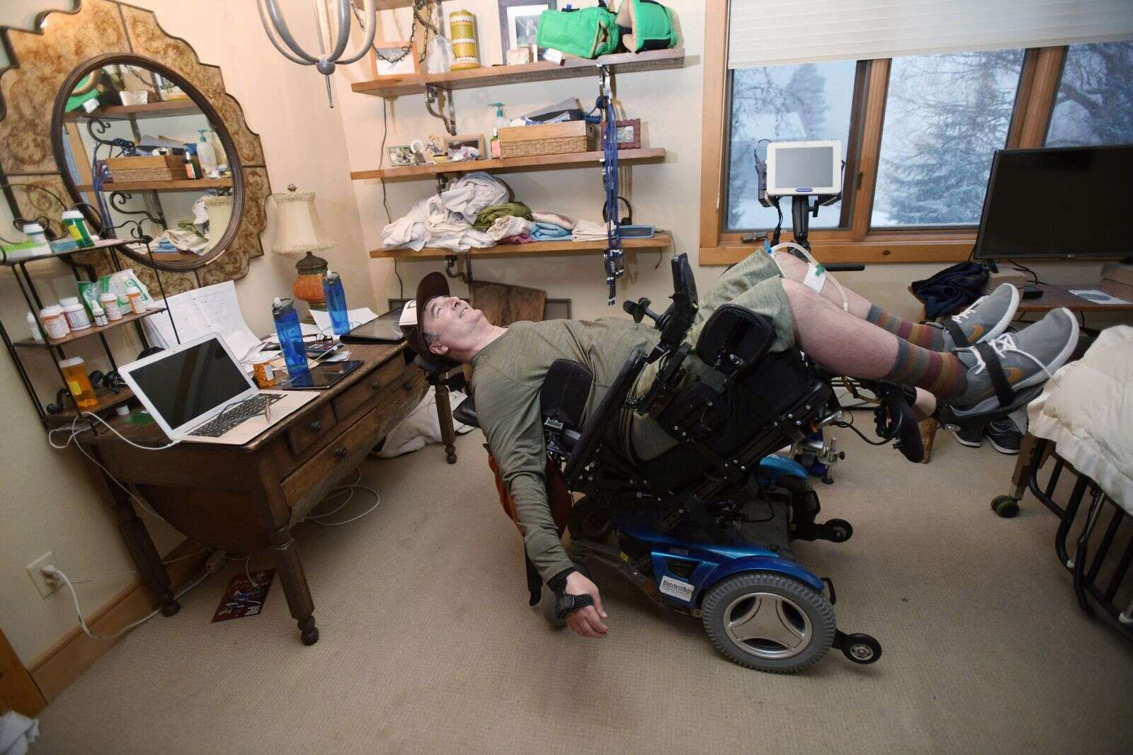 Chris Arnis stretches December 12, 2020, at his Steamboat Springs home. Arnis received a C-4 spinal cord injury after crashing March 15, 2015, at Steamboat Resort. (Matt Stensland, Special to The Colorado Sun)