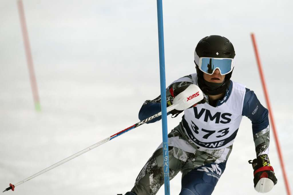 Vail Mountain School Alpine ski team racer Mackay Pattison navigates gates while skiing the slalom course during the Colorado High School State Alpine Ski Championships at Loveland Valley Ski Area on Thursday, March 11, 2021. | Photo by Jason Connolly / Jason Connolly Photography
