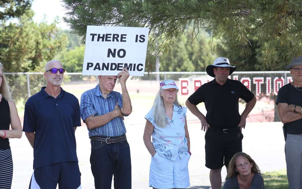A man holds a sign stating that there is no pandemic, during a Protect Nevada County Students press conference July 30 at Bear River High School. | Photo: Elias Funez